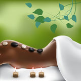 Spa Stone Massage. Woman in spa salon with hot stone massage Royalty Free Stock Photography