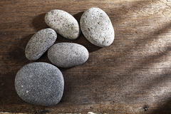 Spa stone. Or pebble on the wooden background Royalty Free Stock Image