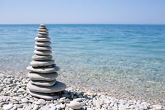 Spa stone on sea coast Royalty Free Stock Photo