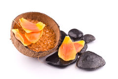 Spa stone therapy on white. Spa stone therapy with orange petales and salt in coconut shell on white Stock Photography