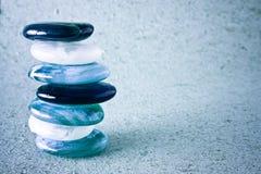 Spa stones. On blue background Stock Image