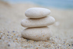 Spa stones. White spa stones on the beach in summer day Royalty Free Stock Photo