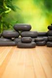Spa stones. Spa treatment - hot massage stones Royalty Free Stock Photos