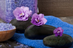 Spa stones. With purple flowers Royalty Free Stock Images