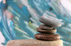 Spa stones. Balanced spa stones at painted background Stock Photos