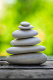 Spa stones against tranquil green background. Balanced spa stones against tranquil green background Stock Photography