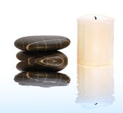 Spa stones with candle Stock Photos