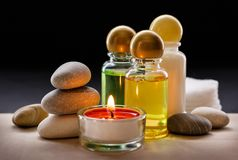 Spa stones, candle and shampoo Stock Photo