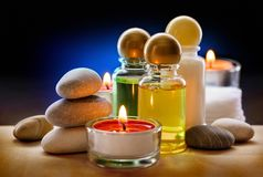 Spa stones, candle and shampoo Royalty Free Stock Photography