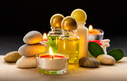 Spa stones, candle and shampoo bottles Stock Photography