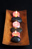 Spa stones and candles Royalty Free Stock Photo