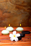 Spa stones, candles and frangipani flower Stock Photography