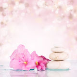 Spa stones on colorful background stock photo