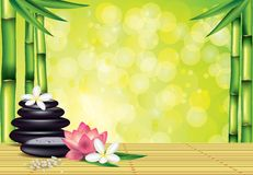 Spa stones and flowers on bamboo background Stock Photo