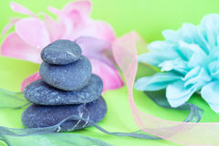 Spa stones & flowers, wellness/beauty care. Natural beauty care and wellbeing, spa stones and flowers Royalty Free Stock Images