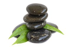 Spa stones and green leaves Royalty Free Stock Photo