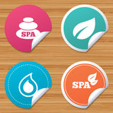Spa stones icons. Water drop with leaf symbols. Stock Images