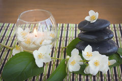 Spa stones and jasmine Stock Images