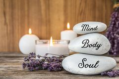 Spa stones with lavender flowers and candles royalty free stock photos