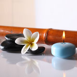 Spa stones and lit candle Royalty Free Stock Photography