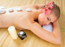 SPA stones massage woman Stock Images