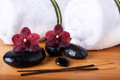 Spa stones and orchids Stock Image