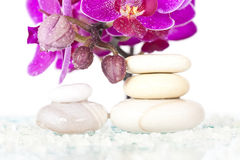 Spa stones and pink orchid Royalty Free Stock Image