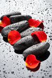 Spa stones with rose petals Stock Photo