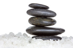 Spa stones in a sea salt Royalty Free Stock Photo