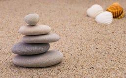 Spa stones with shellfish. On sand Stock Image