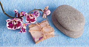 Spa stones, soap and pink orchid Royalty Free Stock Photography