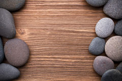 Spa stones. Spa stones in te wooden background Stock Image