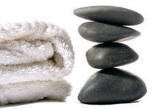 Spa stones and towel Stock Images