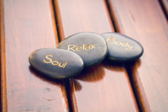 Spa stones on wooden background Royalty Free Stock Photography