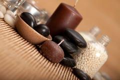 Spa supplies - bath salt and black stones Stock Images