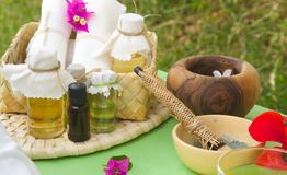 Spa table with skin care products. Spa table with skin care product: esoteric,essential oils,clay facial masks stock image