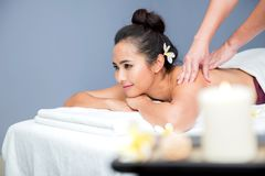 Spa and Thai massage. Beautiful woman relaxing and healthy of aromatherapy Stock Image