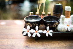 Spa Thai setting for aroma therapy and sugar and salt massage with flower on the bed, relax and healthy care. Royalty Free Stock Images