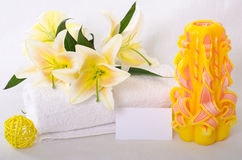 Spa theme with business card. Spa scene with towel, lily and candle, featuring a business card Stock Photos