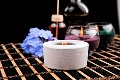 Free Spa Theme With Candles And Flowers On Black Background Stock Photos - 103882713