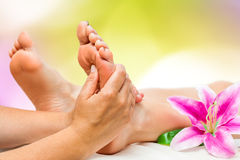 Spa therapist doing foot massage Royalty Free Stock Image