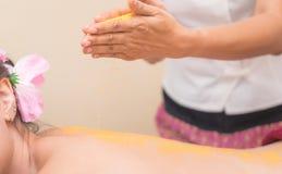 Spa Therapist putting Salt scrub on women back Royalty Free Stock Photos