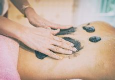 Spa therapist is rubbing charcoal coffee scrub stock photography