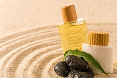 Spa therapy cosmetic products with zen stones Stock Images