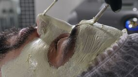 Spa therapy for handsome man getting rejuvenating facial treatment. cosmetology and beauty concept. Concept of men