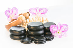 Spa therapy with hot stones, massage roller and cellulite massager Royalty Free Stock Photo