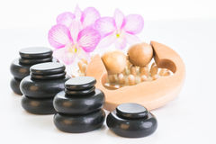 Spa therapy with hot stones, massage roller and cellulite massager Royalty Free Stock Photos