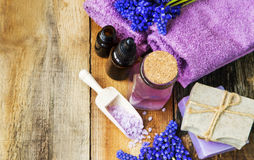 Spa therapy still life products with blue flowers, towels on woo Stock Images