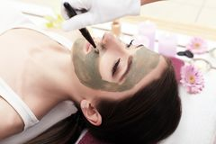 Spa therapy for young woman having facial mask at beauty salon Royalty Free Stock Photography