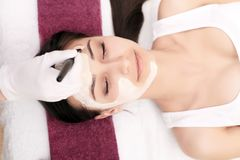 Spa therapy for young woman having facial mask at beauty salon -. Indoors Royalty Free Stock Photography